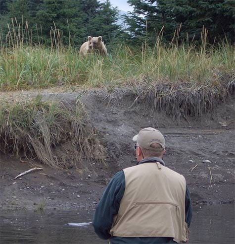 One of our guests watches a nearby bear while fishing