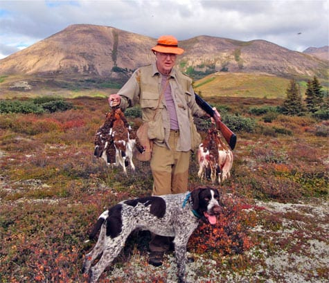 Man and dog after a successful ptarmigan hunt