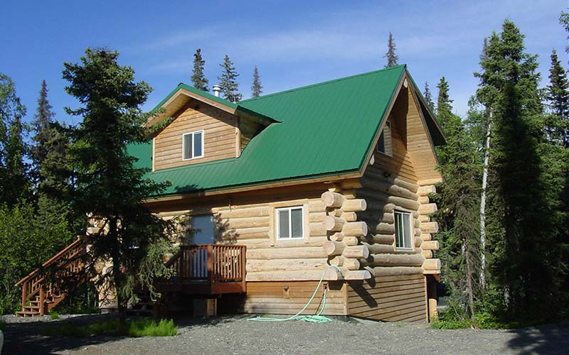 Exterior view of main cabin at All Alaska Outdoors lodge