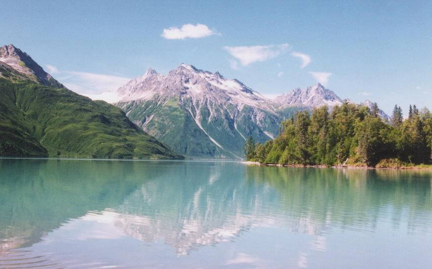 Mountains reflected in water in Lake Clark National Park
